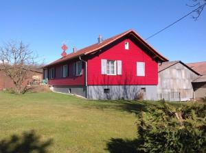 Construction bardage rouge d'une maison en Alsace dans le haut rhin (68)
