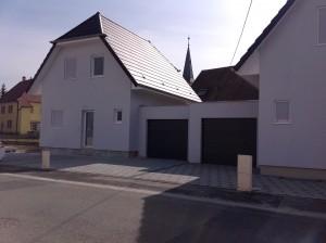 Maison en ossature bois avec garage vue de face