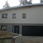 Maison en ossature bois avec toiture cintrée. Vue avant.