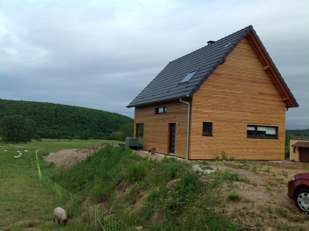 Maison en bois avec bardage horizontal en bois. Maison à ossature bois en Alsace