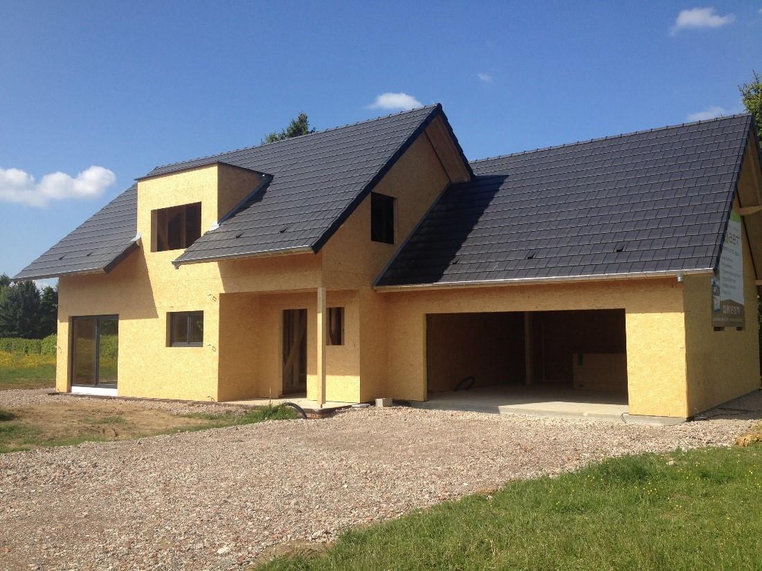 Maison deux pans en ossature bois abt construction bois for Constructeur de garage bois